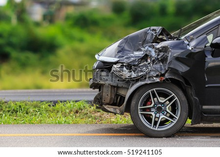 Front of black car get damaged by accident on the road