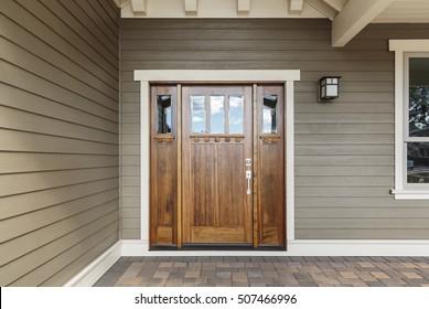 Front brown door with a window