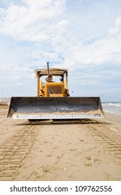 in front of the bulldozer on the beach
