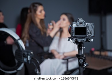 In front of the camera to recording vlog video live streaming at home.Business online influencer on social media concept. Makeup cosmetic at home. Focus on tripod mounted camera screen showing .