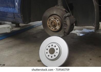 Front car disc brake in process of replacement in the car repair shop.