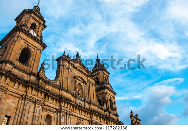 The front of the cathedral in Bogota, Colombia with a blue sky behind it.