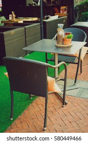 Front of coffee shop with table and chair