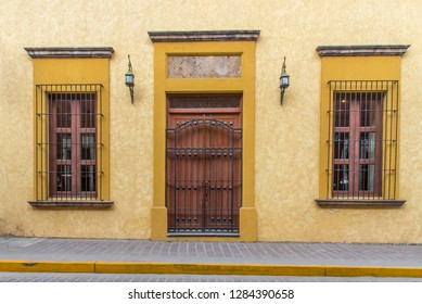 front of colorful mexican house with metal balconies and traditional plants, Tequila Mexico