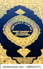 """Front cover of the Noble Qu'ran with English """"The Nobel Qur'an.  Engish translation of the meanings and commentary"""""""