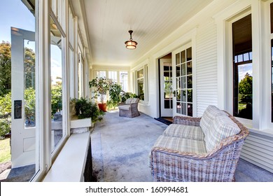 Front covered porch interior. Old classic American craftsman style home.