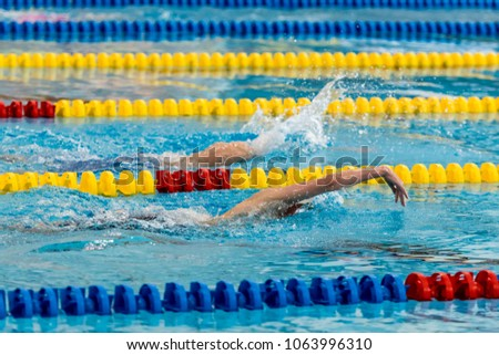 Front crawl nk games swimming pool stock photo edit now 1063996310