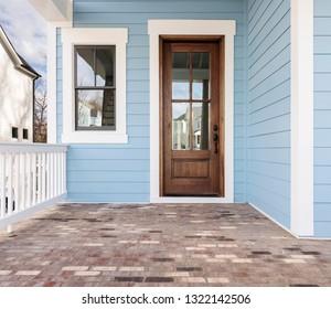 Front door, brown front door with light blue exterior
