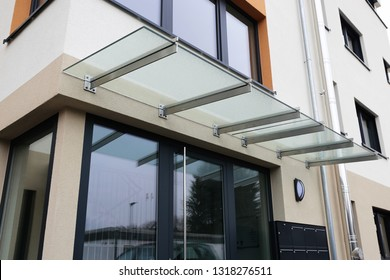 Front door canopy made of glass