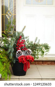 Front door with a Christmas decor