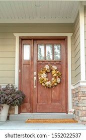 Front door with dried flower wreath day