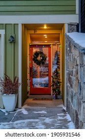 Front door entrance of house with wreath christmas tree and colorful lights