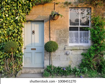 Front Door and Exterior of a Beautiful English Town House Bathed in Warm Evening Sunlight