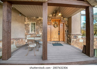 Front door exterior of a house with half stone sidings