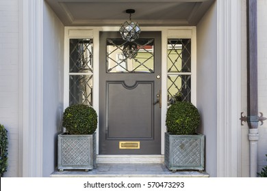 Front door with a grand entryway