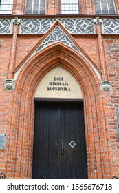 Front door to the house of Nikolai Copernicus (15th century). Torun, Poland. Polish text - House of Nikolai Copernicus