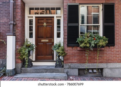 Front door with an Inviting entryway with plants greeting the visitor