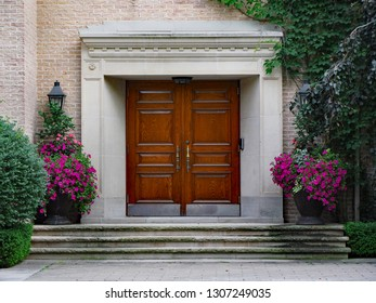 front door of large expensive house with elegant wooden double front door