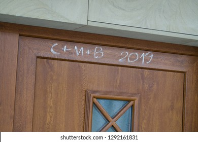Front door with religion inscription