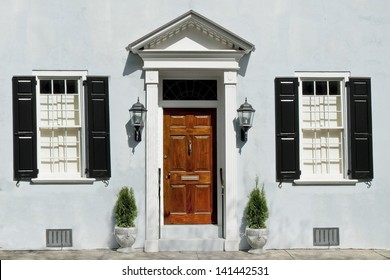 The front door of a romanesque style house, built in the eighteenth century in Old Town Charleston, South Carolina.