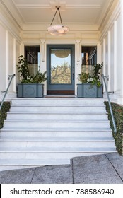 Front door with steps leading up to an elegant entryway
