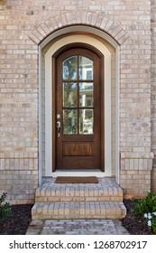 Front door with a stone facade