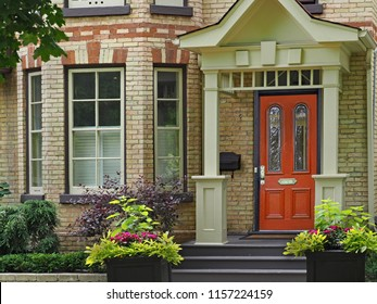 front door of Victorian house with multicolored brick