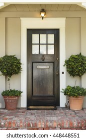 Front door, front view of a brown front door with an inviting entrance