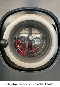 Front door washing machine with cloths inside