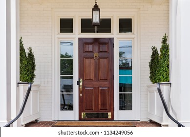 Front door with a white exterior