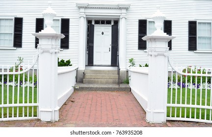 Front Door Of White House With White Fence
