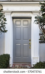 Front door with a white portico