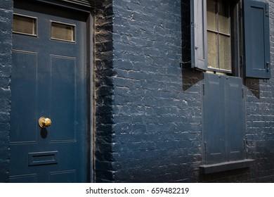 Front door and window shutters in London street.
