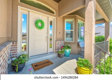 Front door with wreath transom window and sideligts at the facade of a home
