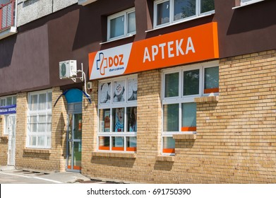 Front of a DOZ Apteka pharmacy entrance on the base floor of a apartment building on August 2017 in Poznan, Poland