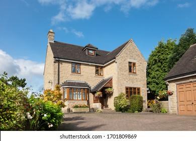 Front of elegant english detached house
