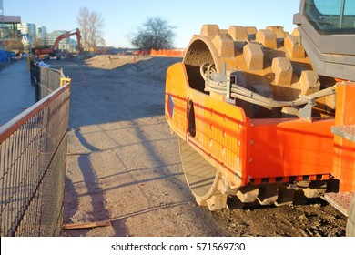Front end of heavy industrial machinery used for compacting soil for road paving/Front End of Industrial Compacting Machine/Front end of industrial machinery used for compacting soil for road paving.