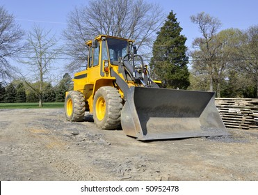 Front end loader construction equipment at a worksite