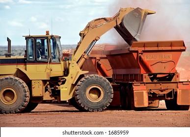 Front End Loader delivering Gold Ore into truck