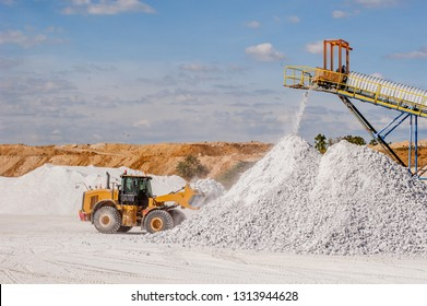 Front end loader and gypsum stock pile