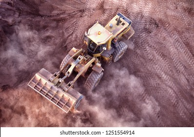 Front end loader working gold ore stockpile to send to processing plant
