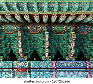 Front entrance detail of the Gyeongbokgung Palace with traditional painted ornaments in Seoul, Republic of Korea