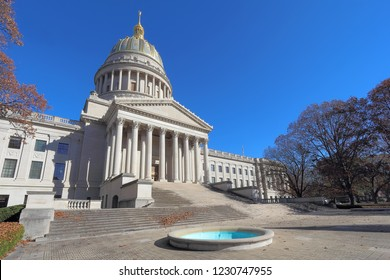 Front entrance and dome of the West Virginia capitol building along the Kanawha River in Charleston against a blight blue autumn sky