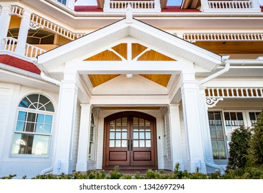Front entry way of house featuring PVC trim, millwork, and columns