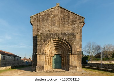 Front facade and decorated architrave of the thirteenth-century Romanesque Church Sao Salvador of Bravaes.