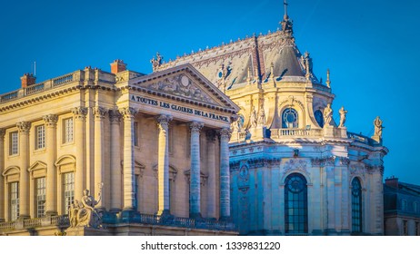 Front facade details with the entrance of the palace Versailles in Paris, France. The Palace Versailles was a royal chateau. The UNESCO World Heritage Sites famous palace in winter.
