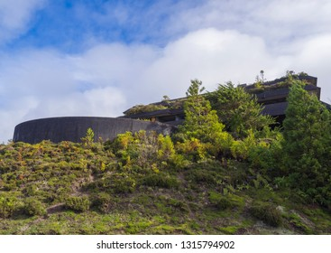 Front facade ruin of abandoned five star hotel Monte Palace near the village of Sete Cidades on the island of Sao Miguel, Azores, Portugal