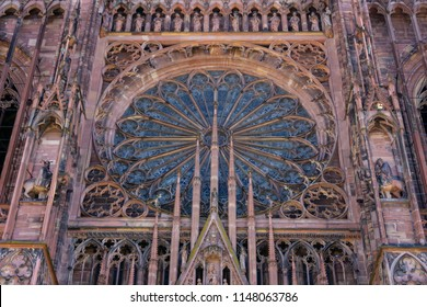 Front facade of the Strasbourg Cathedral with its rose window. Gothic architecture.