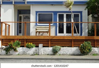 Front facade of stylish beach house at Eve Bay, Wellington south coast New Zealand