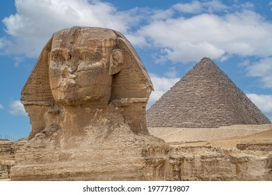The front face and body of the Sphinx and the biggest Great Pyramid of Khafre appear side by side in the desert of Giza, Cairo, Egypt. Horizontal Copy Space. The Sphinx in Giza pyramid. blue sky